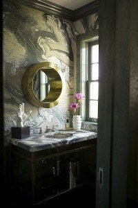 Marble-bathroom-in-rich-colors-with-marble-powder-room-with-round-mirror