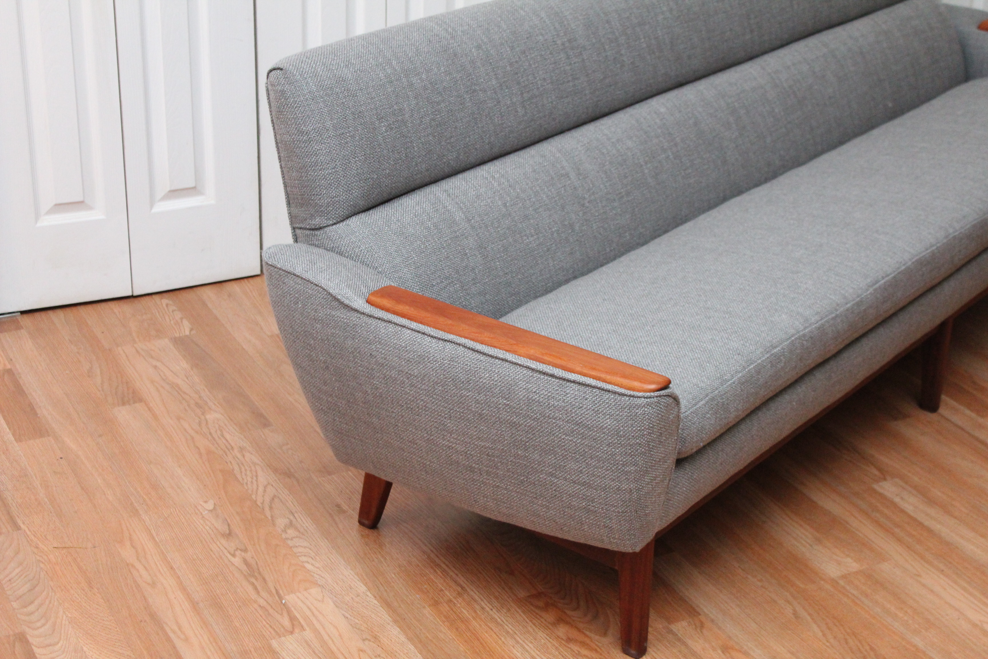 Mid Century Modern Danish Sofa With Teak Armrests An Orange Moon