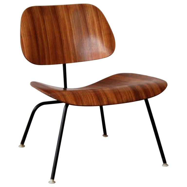 eames lcm zebra wood lounge chair an orange moon uber